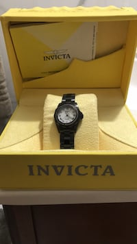 Round black invicta chronograph watch with link bracelet North Bellmore, 11710