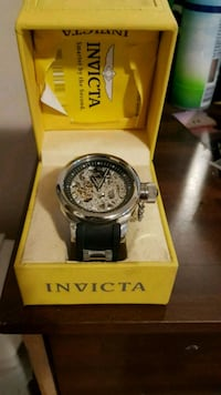 round silver Invicta chronograph watch with black  Calgary, T2L 2J5