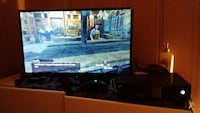 black flat screen TV with remote and xbox1