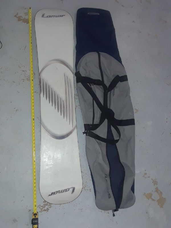 white Lamar snowboard with case