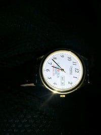 round silver analog watch by bulova Oshawa, L1J 4S2