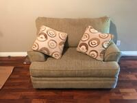 brown fabric sofa chair with throw pillow Calgary, T2B 1T4