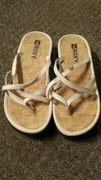 brown-and-white Roxy sandals