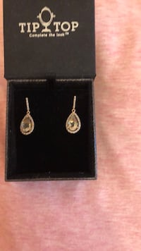 pair of gold-colored earrings New York, 11209