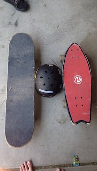 black skateboard, longboard, and helmet