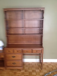 brown wooden shelf with cabinet