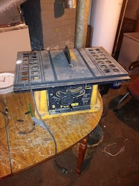 black and yellow corded table saw