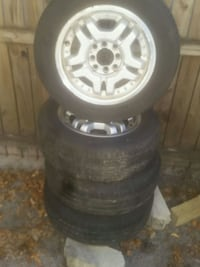 Set of 8 lug 185 65 R14 rims and tires
