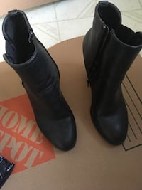 pair of black leather boots Gatineau, J8Y 2J6