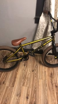 black and yellow BMX bike