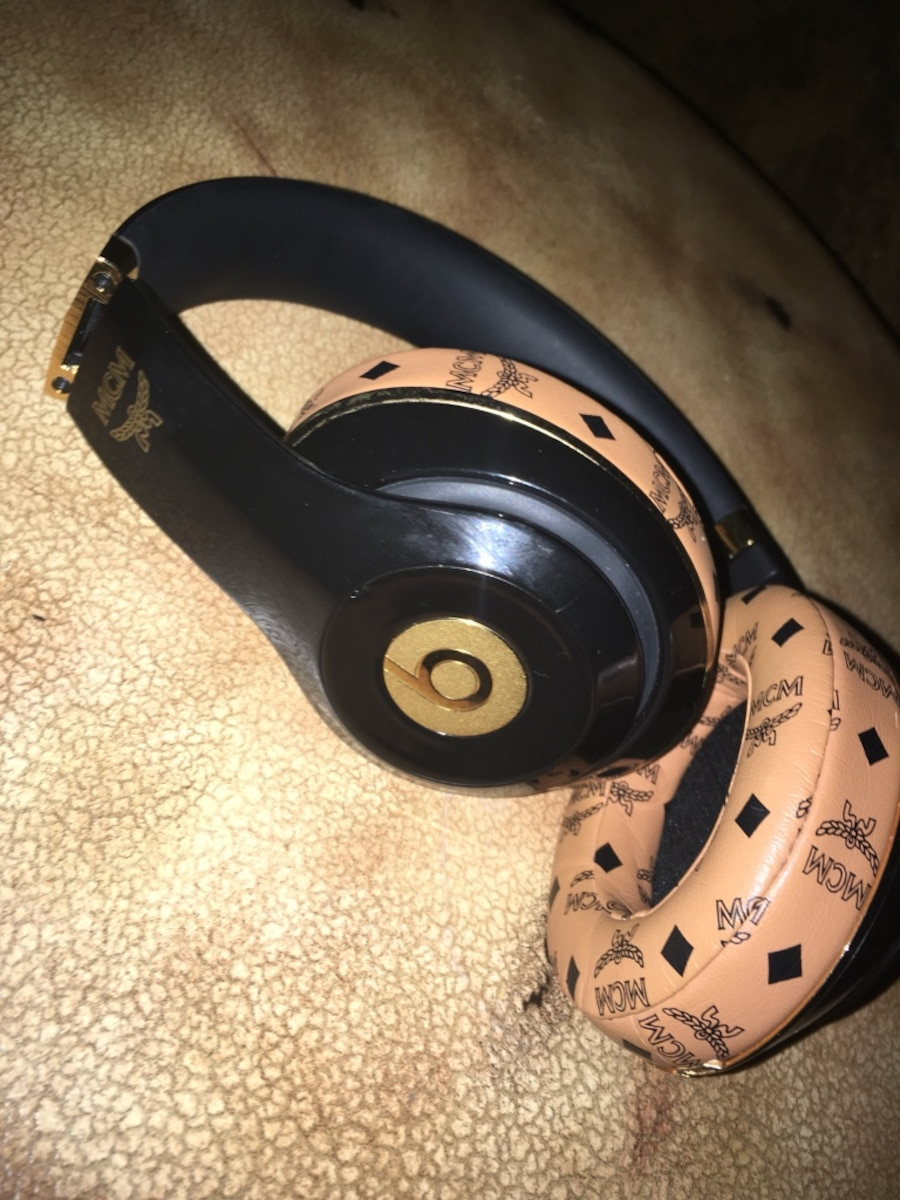 Black and gold Beats By Dr. Dre collab MCM cordless headphones - $100