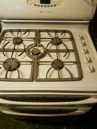 white and black 5-burners gas range oven