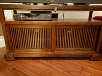 brown wooden framed glass top TV stand Vancouver, V6E 1A7