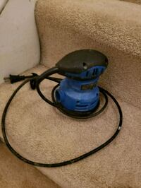 blue and black canister vacuum cleaner 534 km