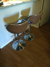 two gray steel base brown leather padded swivel chairs Phoenix, 85018