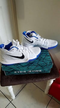 pair of white-and-blue Nike Kyrie Irving basketball shoes with box