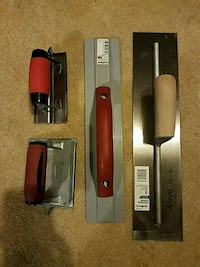 Brand new concrete finishing trowel and other conc Greer