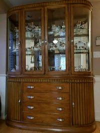 brown wooden framed glass display cabinet 542 km