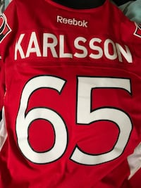 white and red Reebok Karlsson 65 jersey shirt Dartmouth, B3A 4X7