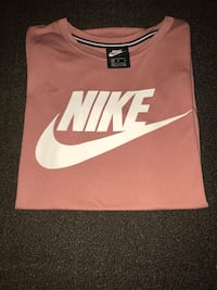 brown and white Nike tank top 1963 km