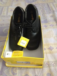 Pair of black leather lace-up shoes new in excellent condition .