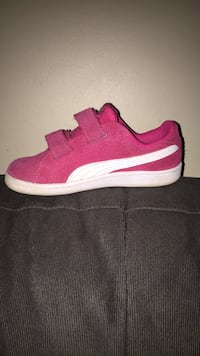 Pair of pink-and-white puma running shoes Kelowna