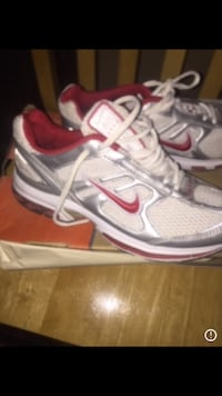 pair of gray-and-red Nike running shoes Lancaster, 93535
