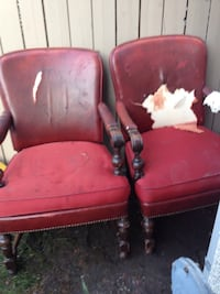 two red leather padded armchairs Calgary, T2A 3S1