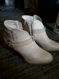 pair of white leather booties 469 km