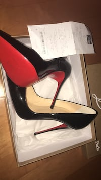 pair of black Christian Louboutin  shoes