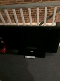 Philips tv with lights on the side and remote Baltimore, 21224