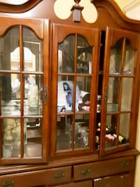brown wooden china cabinet with glass display cabi Houston, 77012