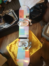 Women's snow board and size 5 boots.