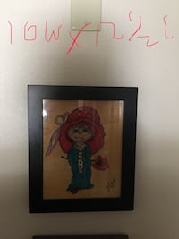 Black wooden framed painting from local artist  Holiday, 34690