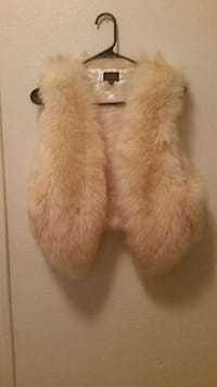 white and brown fur vest
