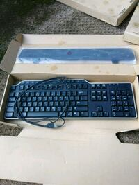 black and blue corded computer keyboard 29 km