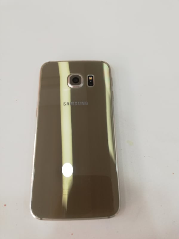 Samsung Galaxy S6 Edge. 7099d5eb-4637-42ea-ba2d-41e2bad211f7