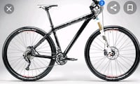 I'm looking for a 29in wheel mountain bike with front shocks and disc  Cambridge