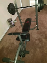 110 pound free weights and bench