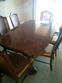 oval brown wooden table with six chairs dining set Cerro Gordo, 61818