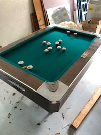 Bumper pool table with all balls and 2 cues
