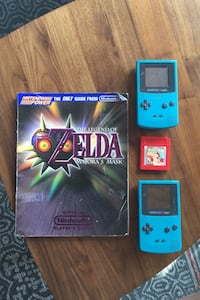 Two game boys, game, and Zelda player's guide