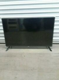 black flat screen TV with remote San Jose, 95112