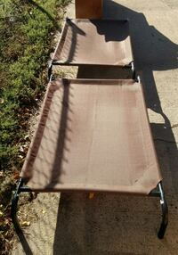 Two Available Steel framed elevated pet beds $10 each, Firm Sioux Falls