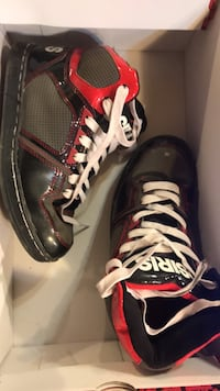 Pair of black-and-red running shoes size 6 Des Moines, 50321