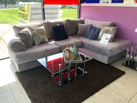 gray fabric sectional sofa with throw pillows Houston, 77084