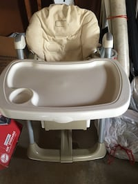 white and gray highchair 14 km