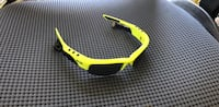 Oakley polarizing sun glasses custom made with ear sound plugs.  New York, 11375