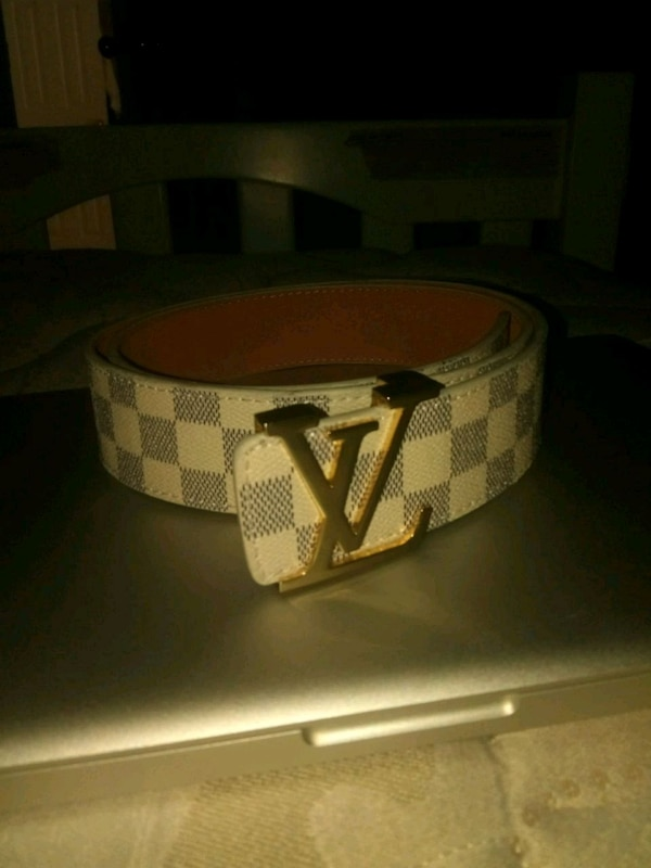 brown and black Louis Vuitton leather belt