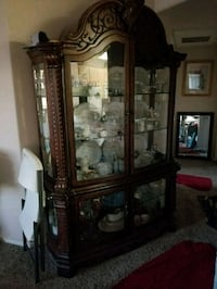 brown wooden framed glass display cabinet Albuquerque, 87122